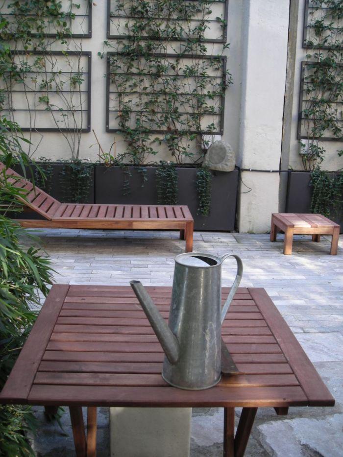 cortile privato con jacuzzi fra bambù e rampicanti a milano_4